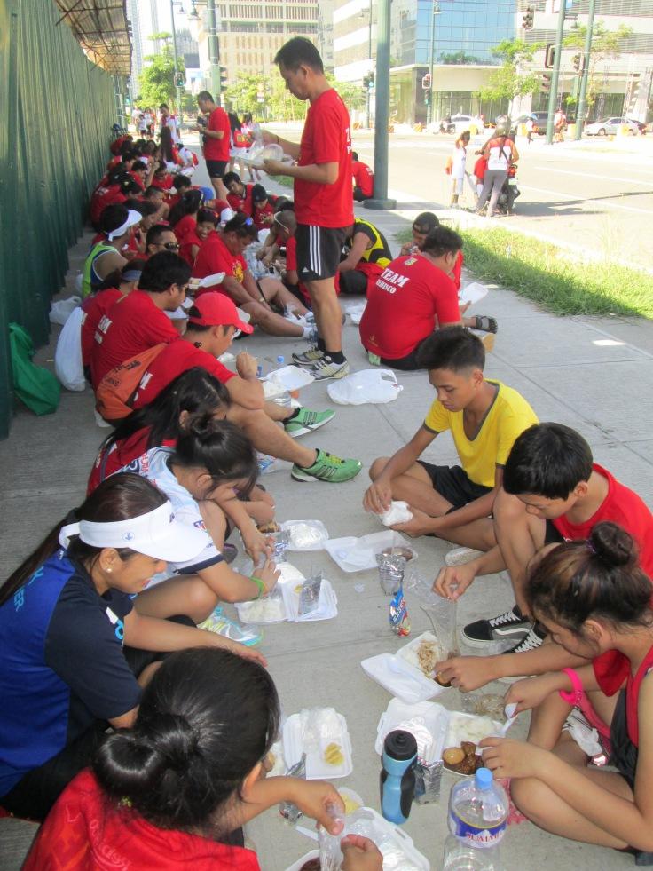 Volunteers/marshals replenishing themselves.