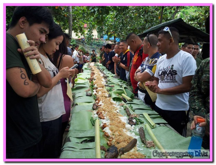 Boodle Fight!!! Participants and military personnel all share the blessings.