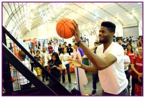 Nerlens Noel got palms that could cover almost half the ball!